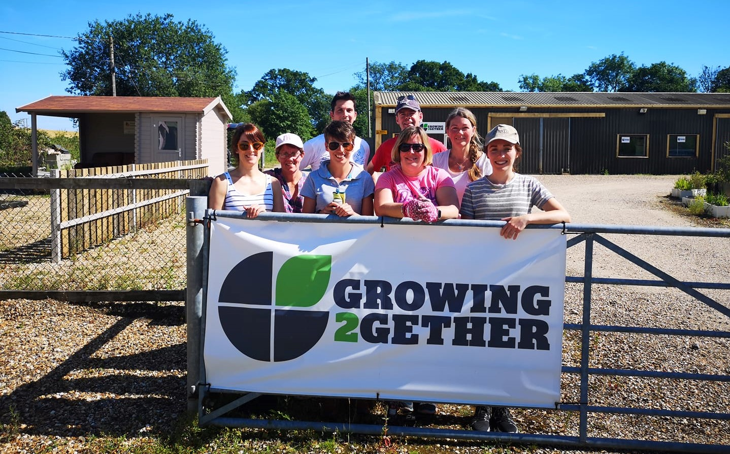 Growing2Gether volunteers & sign