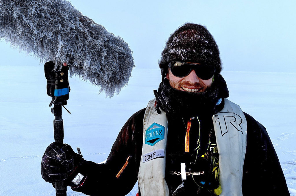 Tom holding his boom microphone dressed for the Arctic weather conditions