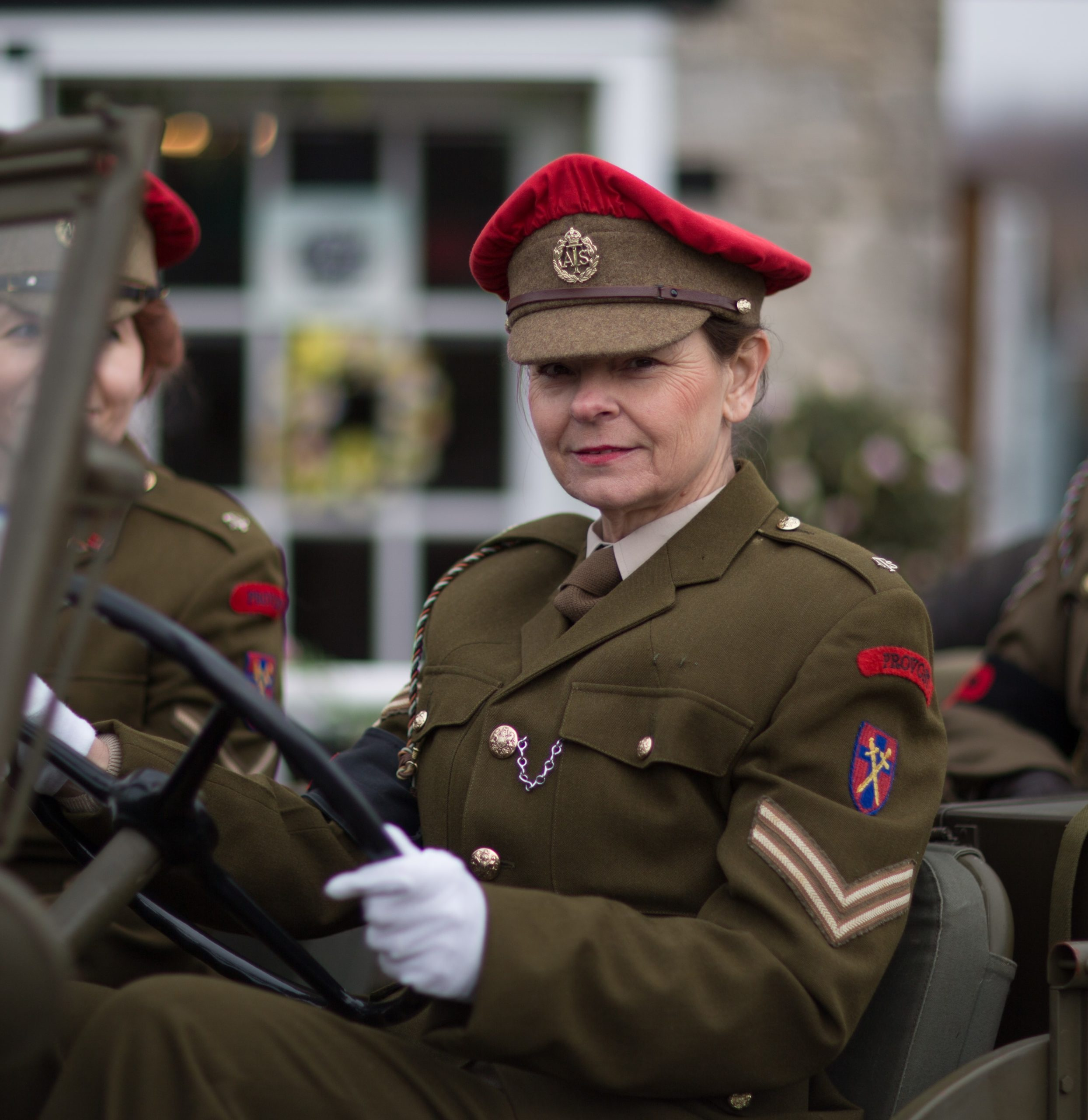 Womens wartime roles included Auxiliary Territorial Service here shown in the portrayal of a Military Policewoman.
